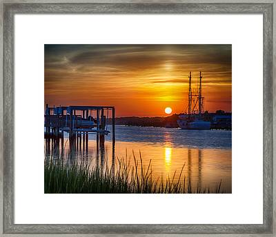 Days End On Water Framed Print