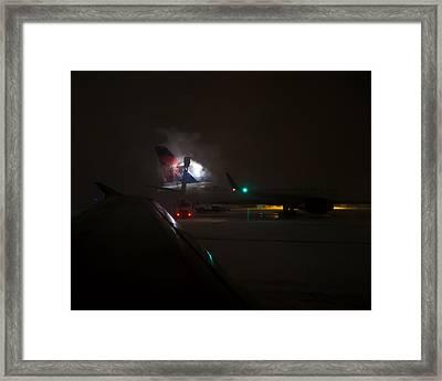 De-icing Delta In Detroit Framed Print by Rona Black