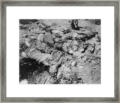 Dead Slave Laborers Lie In A Barracks Framed Print