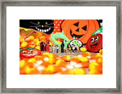Death Takes His Kids Trick Or Treating Framed Print by Lon Casler Bixby