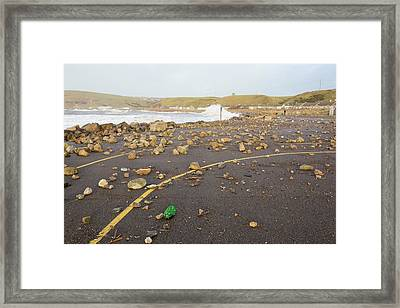 Debris Hurled Onto The Seafront Framed Print