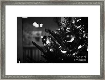decorated christmas tree looking out of window to snow covered scene in small rural village of Forge Framed Print