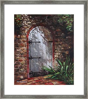 Decorative Door In Archway Set In Stone Wall Surrounded By Plants Framed Print by Martin Davey