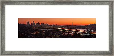 Deep Sunset Hues Of The Seattle Skyline Framed Print by Mike Reid