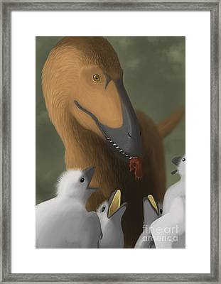 Deinonychus Dinosaur Feeding Its Young Framed Print by Michele Dessi