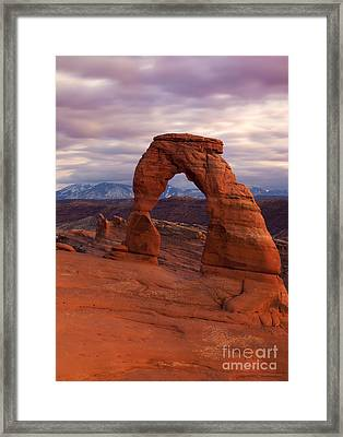 Delicate Arch Dusk Framed Print by Mike Dawson