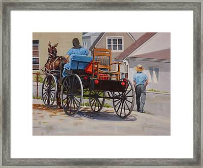 Delivering The Chair Framed Print