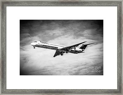 Delta Air Lines Airplane In Black And White Framed Print by Paul Velgos