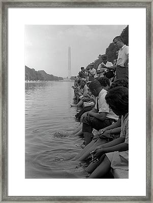 Demonstrators Sit Along The Reflecting Framed Print by Stocktrek Images