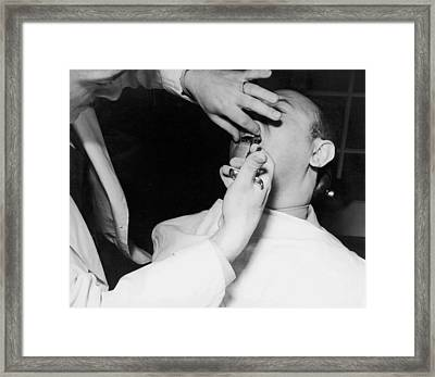 Dentist Giving A Novocain Shot Framed Print by Underwood Archives