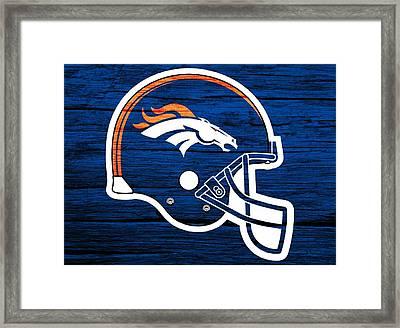 Denver Broncos Football Helmet On Worn Wood Framed Print by Dan Sproul