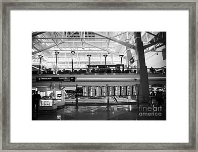 departures board at concourse b Denver International Airport Colorado USA Framed Print by Joe Fox