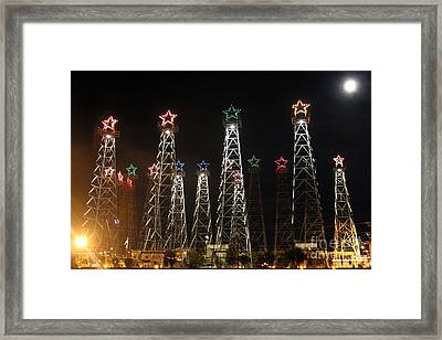 Derricks Under A Full Moon Framed Print by Kathy  White