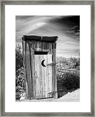 Desert Outhouse Under Stormy Skies Framed Print by Lee Craig