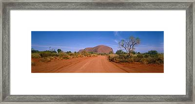 Desert Road And Ayers Rock, Australia Framed Print by Panoramic Images