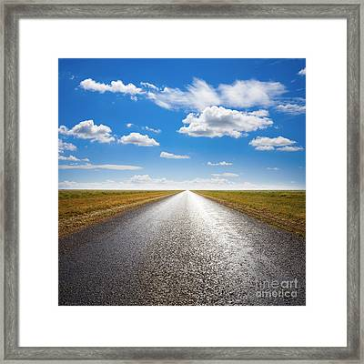 Desert Road And Dramatic Sky Framed Print by Colin and Linda McKie