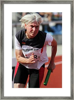 Determined Female Senior Athlete Running Framed Print by Alex Rotas
