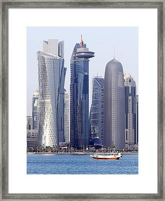 Dhow And Doha Towers Framed Print by Paul Cowan