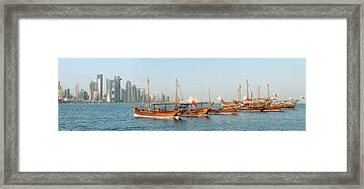 Dhows On Parade In Doha Framed Print by Paul Cowan