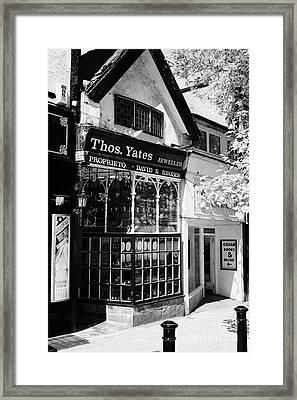 dickensian frontage of thomas yates jewellers shop Preston England UK Framed Print