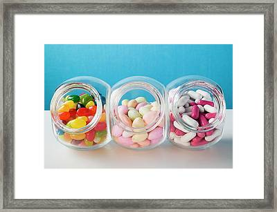 Different Kinds Of Sweets In Three Sweet Jars Framed Print