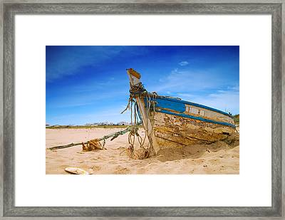 Dilapidated Boat At Ferragudo Beach Algarve Portugal Framed Print by Amanda Elwell