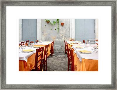 Dining Alfresco In Italy Framed Print by Annie  DeMilo