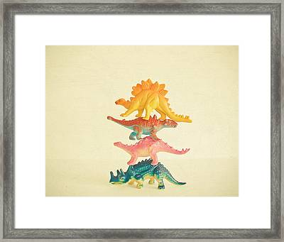 Dinosaur Antics Framed Print by Cassia Beck