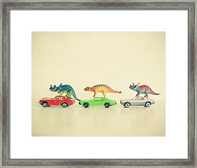 Dinosaurs Ride Cars Framed Print by Cassia Beck