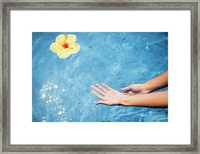 Dipping Hands In The Water Framed Print by Judi Angel