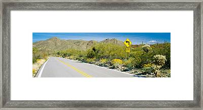 Directional Signboard At The Roadside Framed Print