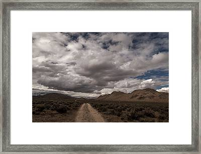 Dirt Road And Clouds Framed Print by Cat Connor