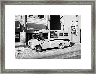 dirty canada post delivery truck on frozen street Saskatoon Saskatchewan Canada Framed Print by Joe Fox