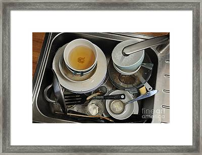 Dirty Dishes In Sink Framed Print by Sami Sarkis
