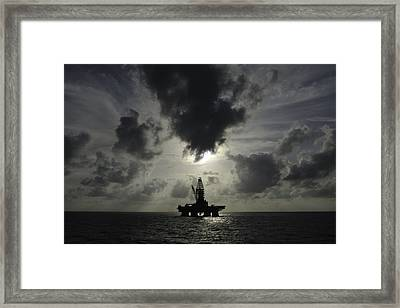 Distant Offshore Oil Rig Framed Print by Bradford Martin