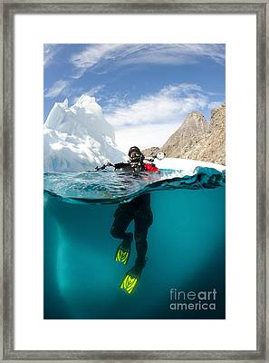 Diver In Front Of An Iceberg, Astrolabe Framed Print by Steve Jones