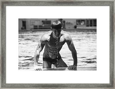 Diver Pulling Himself Out Of The Pool Framed Print