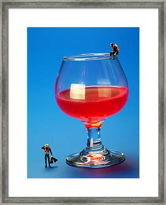 Diving In Red Wine Little People Big Worlds Framed Print