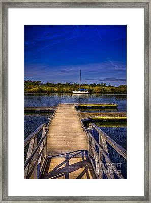 Dock And Boat Framed Print by Marvin Spates