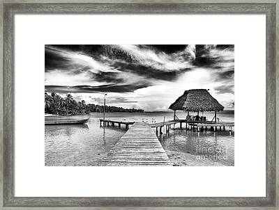 Dock At Drago Framed Print by John Rizzuto