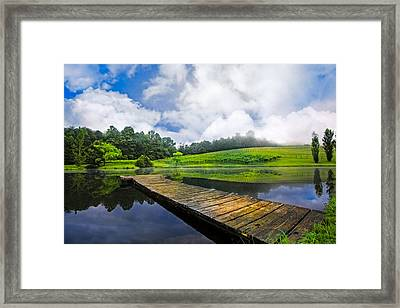Dock At The Winery Framed Print by Debra and Dave Vanderlaan