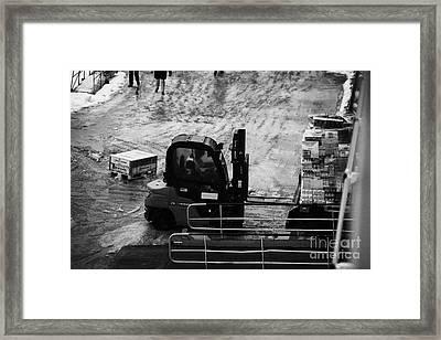 Dock Forklift Truck Unloading Deliveries From Hurtigruten Coastal Ferry Havoysund Finnmark Norway Eu Framed Print by Joe Fox