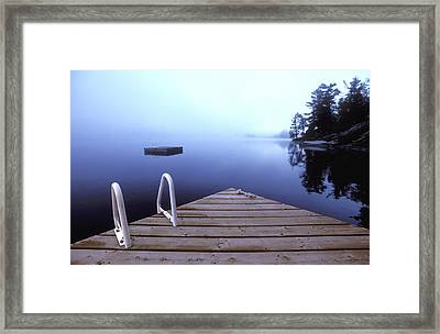 Dock On Lake, Parry Sound, Ontario Framed Print by Kevin Spreekmeester