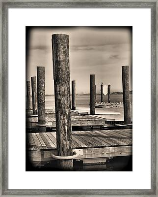 Dock Posts On The Potomac Framed Print by Steven Ainsworth