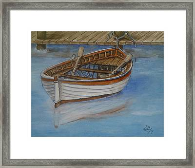 Docked Rowboat Framed Print by Kelly Mills