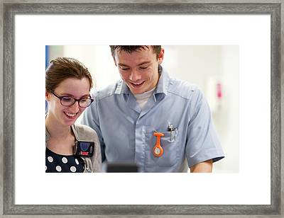 Doctor And Healthcare Assistant Talking Framed Print