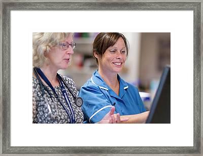 Doctor And Nurse Talking Framed Print