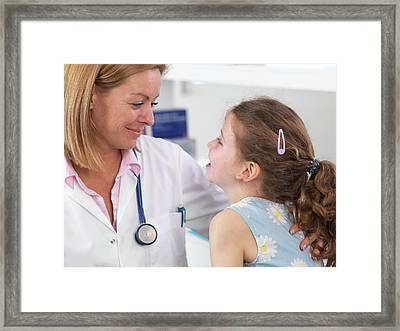 Doctor Caring For Patient Framed Print