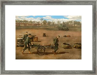 Doctor - Demonstrating A Wheel Litter  Framed Print by Mike Savad