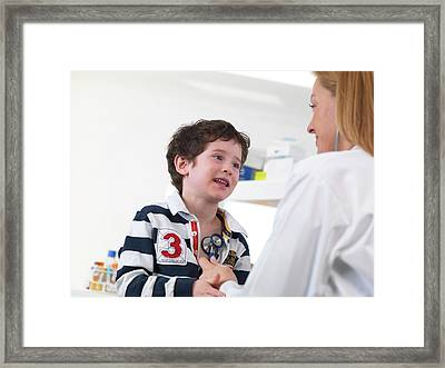 Doctor Examining Child Framed Print by Tek Image